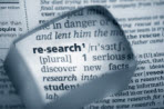 magnifying glass over word research